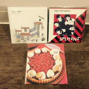 """Part of the day's purchases: 7""""es by Dick Diver, Chook Race and Split Enz"""