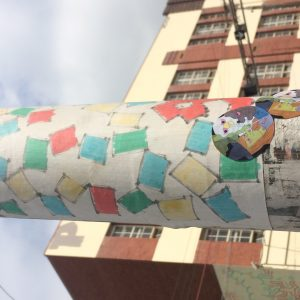 Stickered street-corner pole