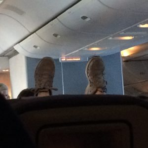 Lady a few rows ahead with her feet up, giving zero fucks